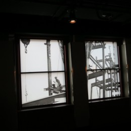 Displays in the windows  give you an idea of what it was like when the Empire  State Building was Built .